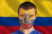 Composite image of serious young ecuador fan with facepaint against digitally generated ecuador national flag