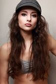 Beautiful Long Hair Woman In Fashion Cap