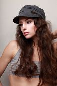 Sexy Young Woman With Long Hair In Trendy Cap. Hipster Modern Lifestyle