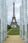 PARIS, FRANCE - OCTOBER 20: The Eiffel tower framed by obelisks of the mur de la paid, in Champ de M
