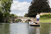 CAMBRIDGE, UK - AUGUST 18: Professional punter in busy River Cam with tree lined bank to one side an