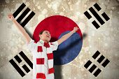 Excited asian football fan cheering against south korea flag