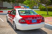 ABU DHABI, UAE - MARCH 27: Police car on the street of Abu Dhabi on March 27, 2014, UAE. Abu Dhabi i