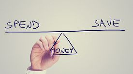 image of seesaw  - Conceptual retro image of whether to Spend or Save your Money with a man drawing a diagram of a seesaw on a virtual screen balancing the two concepts of  - JPG