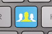 Business White Yellow People on Keyboard