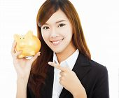 Asian Businesswoman Holding A Golden Piggy Bank