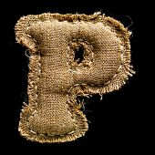 Linen or hemp vintage cloth letter P isolated on black background