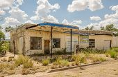 image of neglect  - Neglected automotive repair shop and gas station tried selling auto parts before it was abandoned on Route 66 - JPG
