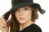 Portrait of beautiful young woman wearing a hat isolated on a white background