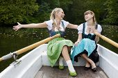 Two Woman In A Rowing Boat