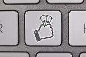 Gray Cash Symbol on a Laptop