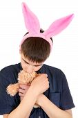 foto of sissy  - Infantile Teenager with Bunny Ears and Teddy Bear Isolated on the White Background - JPG