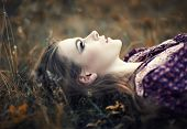 foto of country girl  - portrait of beautiful hippie girl lying on the grass - JPG