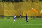 Photographer Shooting A Football Game