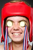 Funny boxer with winning gold medal