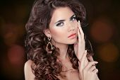 Beautiful Attractive Brunette Woman Model With Wavy Long Hair And Fashion Earrings. Skincare.