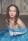 pic of pompous  - Young beautiful medieval woman in long blue dress praying - JPG