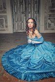 Beautiful Medieval Woman In Blue Dress Praying