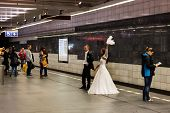 Bride and groom take wedding photos in subway station, Prague Czech Republic