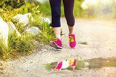 Senior woman running closeup feet