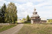 Ancient Wooden Chapel In Northern Russian Village