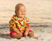 Cute baby on the tropical beach
