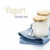 Sour cream or natural yogurt with spoons - health and diet concept