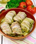 Cabbage stuffed with sauerkraut in ceramic pan on napkin