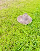 Old Farmer's Hat On Grass Field