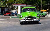 HAVANA,CUBA - June 27, 2014: Green classic car on the road in havana