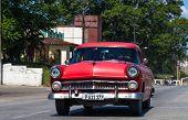 HAVANA,CUBA - June 27, 2014: Red classic car on the road in havana