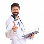 Doctor With Thumb Up Over White Background