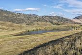 mountain valley and lake - Pineridge Natural Area at Rocky Mountain foothills in Fort Collins, Colorado