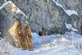 winter landscape with  sandstone rocks and classic Bear Paw snowshoes