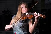 Attractive woman plays on violin