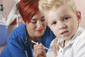 picture of flu shot  - Small boy watching as nurse gives him a shot - JPG
