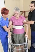 picture of physiotherapist  - Elderly lady with her physiotherapists in a hospital - JPG
