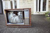 An old broken TV left on the street.