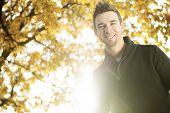 Young men in beautiful autumn park, concept autumn