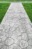 Stone Walkway On Grassy Field