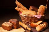 Composition with bread, cutting board and rolling-pin