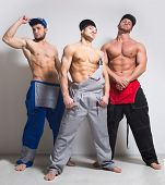 pic of muscle builder  - Three sexy muscular man in working overalls - JPG