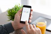 Man Holding iPhone 6 With Google On The Screen