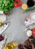 image of sucker-fish  - Fresh fish and vegetables on wooden table - JPG