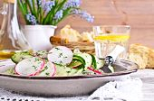 image of radish  - Salad of radish and cucumber on a ceramic plate - JPG