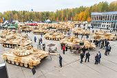 Visitors explore military vehicles on exhibition