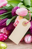pink and violet tulips with easter eggs