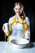 image of homemaker  - Photo of young smiling homemaker with mixer and bowl - JPG