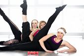 Group Of Women Doing Aerobics Exercises In Class