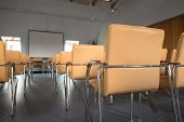 Empty classrom with lot of chairs
